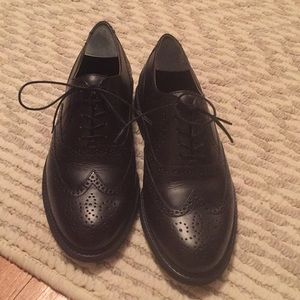 Black wing tip lace up shoe